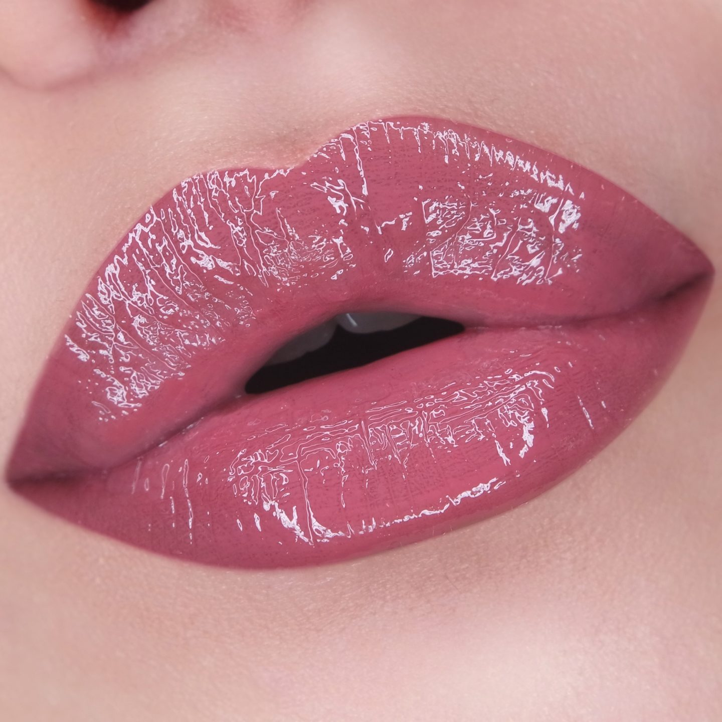 NARS Lip Gloss in Mythic Red Swatch